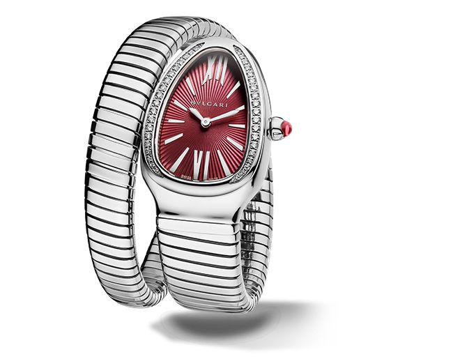 SERPENTI TUBOGASQuartz movement. 35 mm steel curved case set with brilliant-cut diamonds. Steel crown set with a cabochon-cut pink rubellite. Violet lacquered dial with guilloch