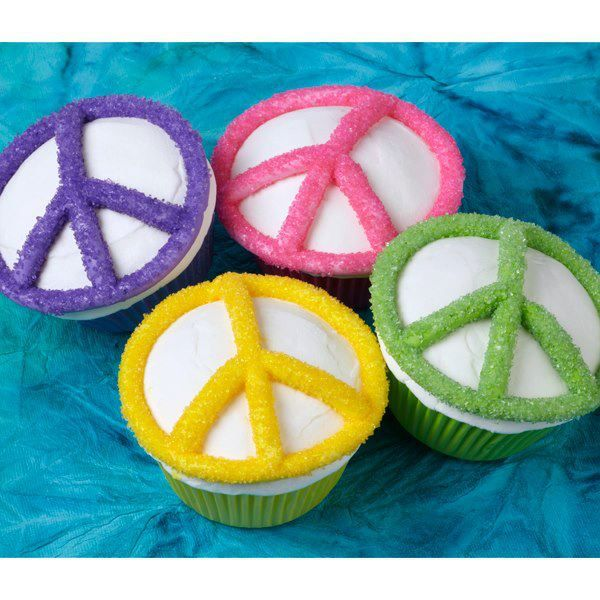 It was a sign of the times in the 60's—now the peace symbol has come full circle for today's parties, with a coating of Wilton Sparkling Sugar in flower-powerful colors.