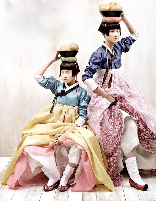 Modern hair and traditional dress. From Korean Vogue.