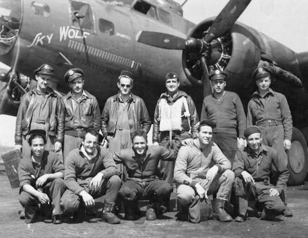 "The crew of ""Sky Wolf,"" a B-17 bomber shot down over Germany on July 13, 1943, is pictured in front of their ill-fated ""Flying Fortress"" shortly after arriving in England. Thy were part of the American 8th Air Force that pulverized the Reich in daily raids over Nazi-occupied Europe. Photo provided"