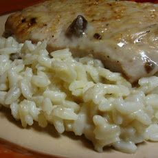 The fastbway: Pork chops, cream of mushroom soup, and rice. Brown the pork chops(I like to chop it in pieces first) stir in cream of mushroom soup then serve over rice.  Slow cooker way: Throw in the chops with soup cook on low for 4-6 hours. Serve over rice