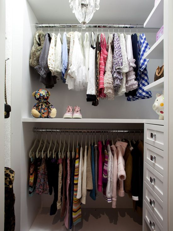 Cute Girly Closet With White Floating Shelves And