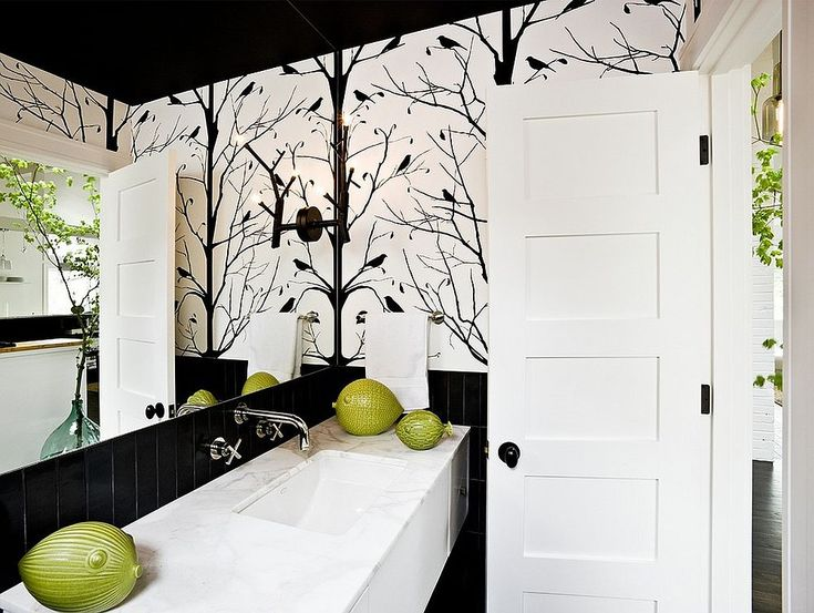 Midcentury style powder room with black and white color scheme Always on Trend: 20 Powder Rooms in Black and White