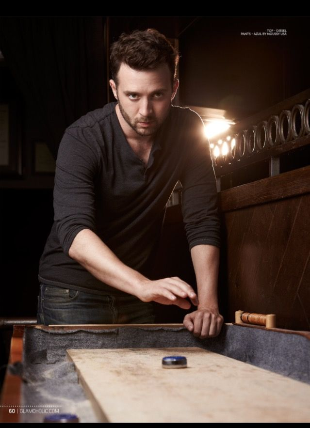 He is staring intensely. Eddie Kaye Thomas