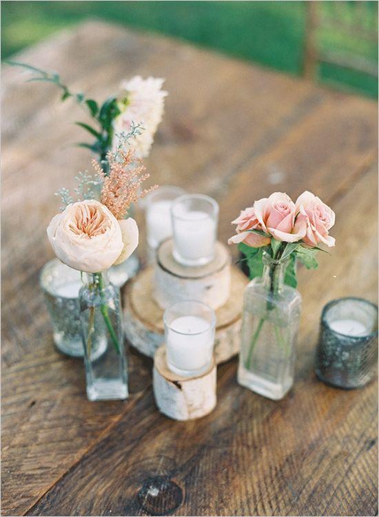 rose and ranunculus centerpieces #diy #weddingreception #weddingchicks http://www.weddingchicks.com/2014/03/20/elegant-wedding-at-the-legare-house/