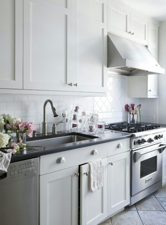 What a georgeous kitchen #LillyBunn #Interiors.  An easy way to get the subway tile look - without the hassle of grout - is to use our Pressed Metal panels in the brick pattern.  They cover an area of 1830mm x 915mm.