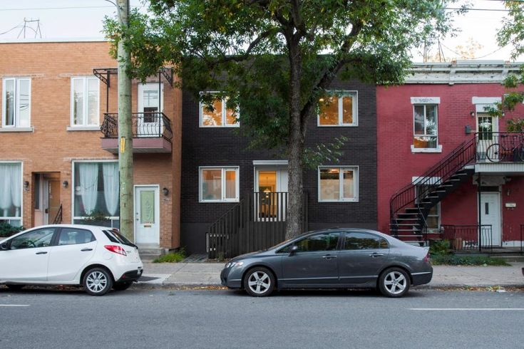Montreal firm Appareil Architecture has combined two dwellings in the city, which involved removing walls to bring in more natural light and creating a new sunken lounge space.
