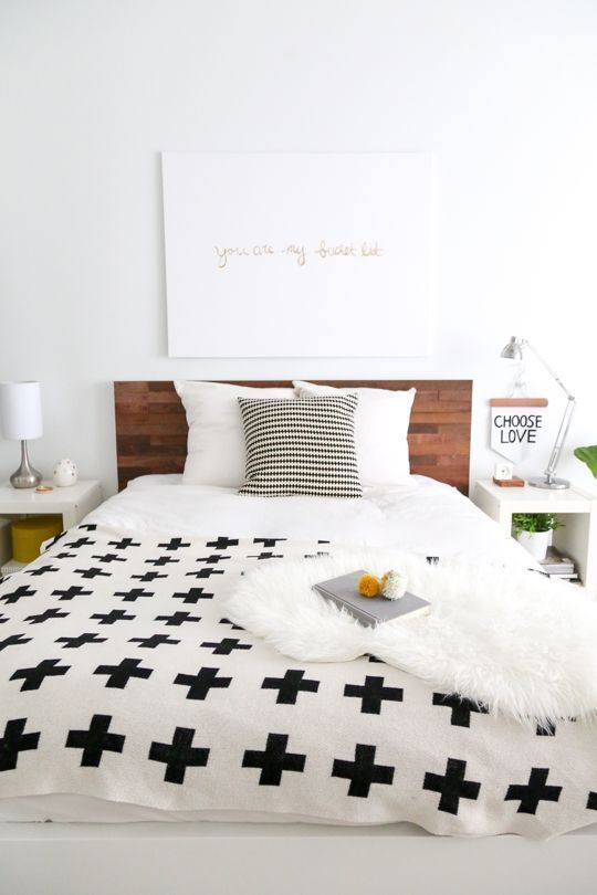 A simple DIY to make a big statement: a DIY Ikea Hack Stikwood Headboard is exactly what your bedroom needs for a polished touch! #diy #ikeahack #furniture #headboard