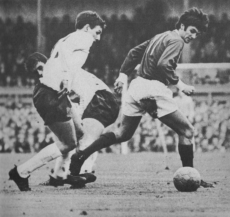 20th October 1966. Northern Ireland winger George Best trying to wriggle past England duo Geoff Hurst and Martin Peters, at Windsor Park.