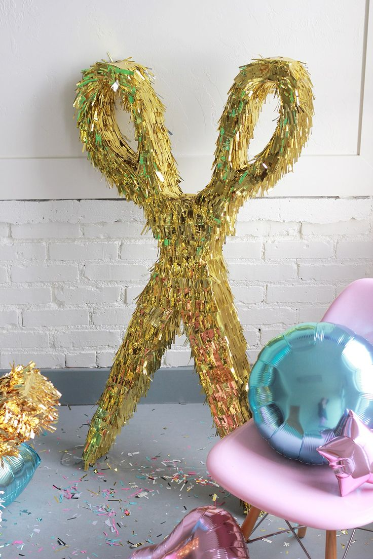 Throw a hair party with some festive pinatas like these scissors pinatas