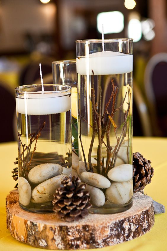 rustic winter pinecones wedding centerpiece with the candles / www.deerpearlflow…
