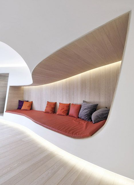 A warren of interconnecting spaces moulded to resemble melting snow form an après-ski apartment in China's Hebei province by Vienna and Beijing-based studio Penda.