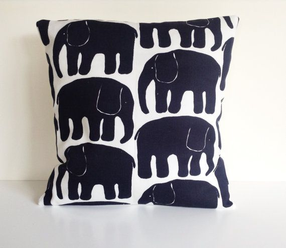 This listing is for one cushion cover in a striking abstract Scandinavian print.    The fabric is 100% cotton with a black elephant print on white