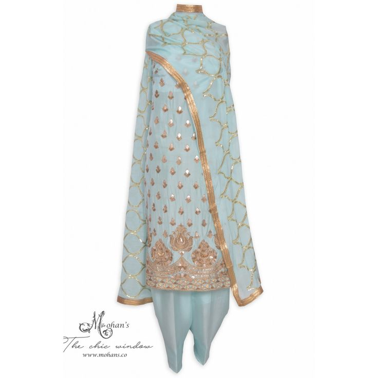 Ethnic aquamarine unstitched suit adorn in rich ornate handwork-Mohan's the chic window
