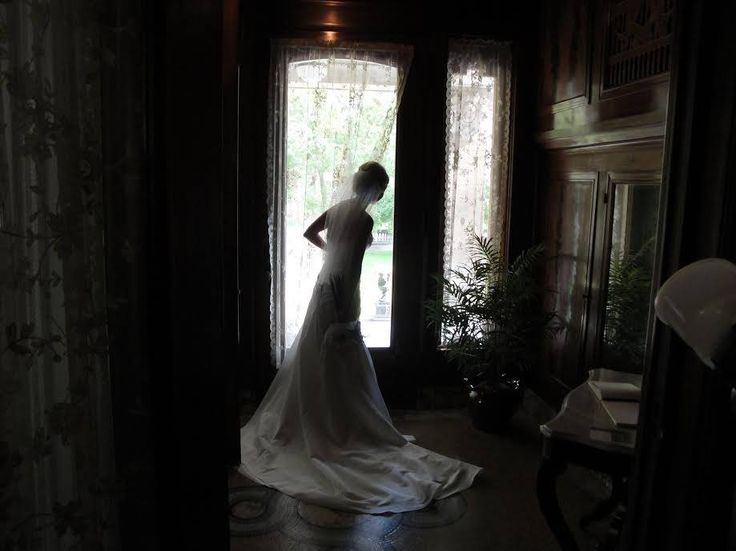 An excited bride anxiously waiting to walk down the isle at Ruthmere