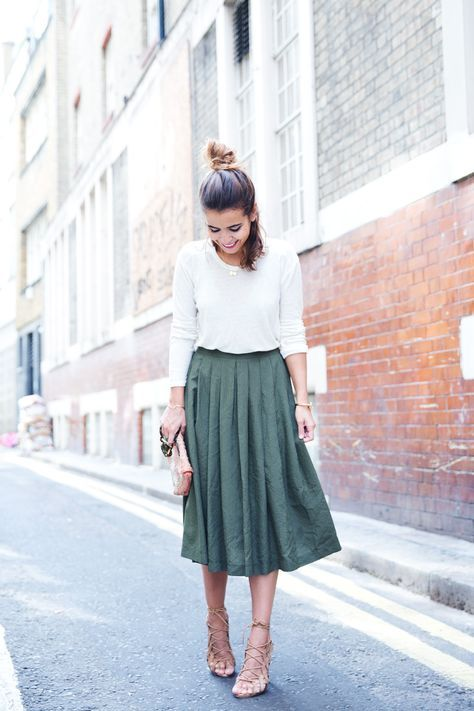 Long sleeved shirt with a midi skirt and lace up sandals or flats