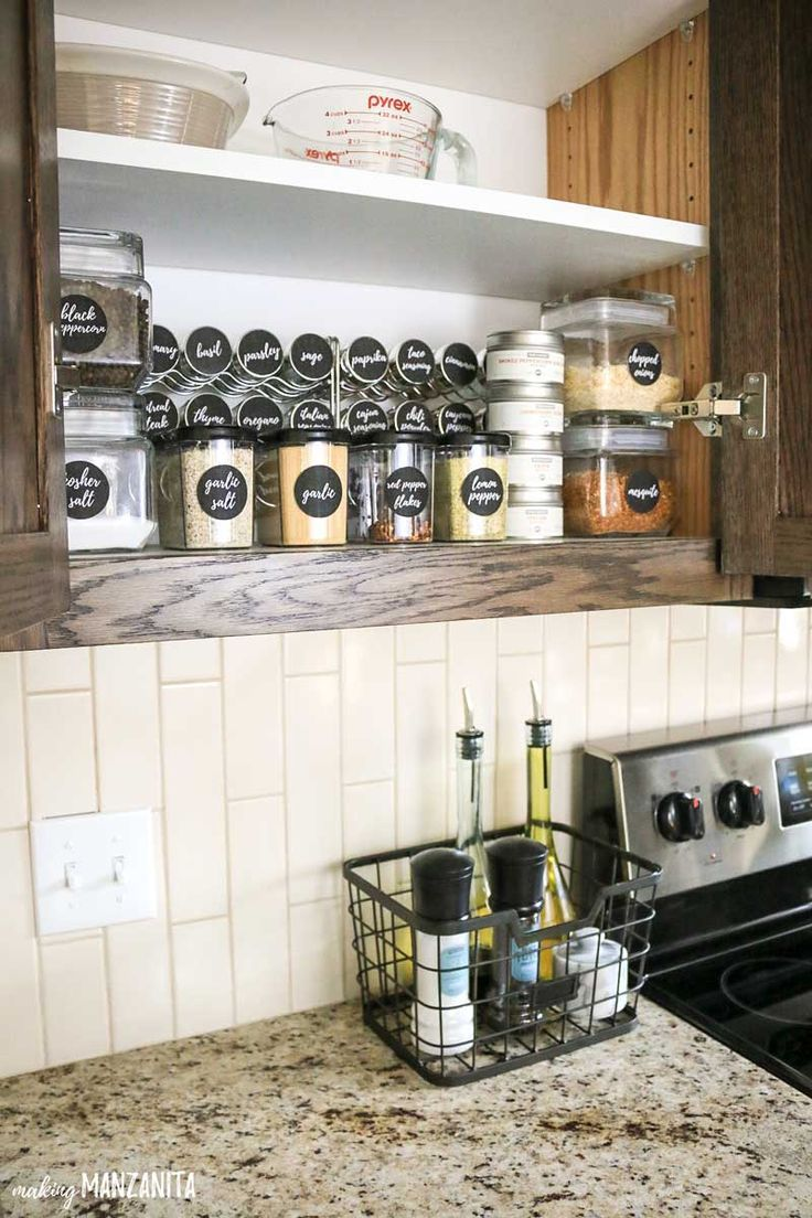 DIY spice organization in cabinet | Small spice kitchen organization ideas | Keep basket on countertop with everyday items, like salt and pepper and olive oil | Spice storage inspiration in cupboard #ad #smallkitchen #spiceorganization #spicestorage