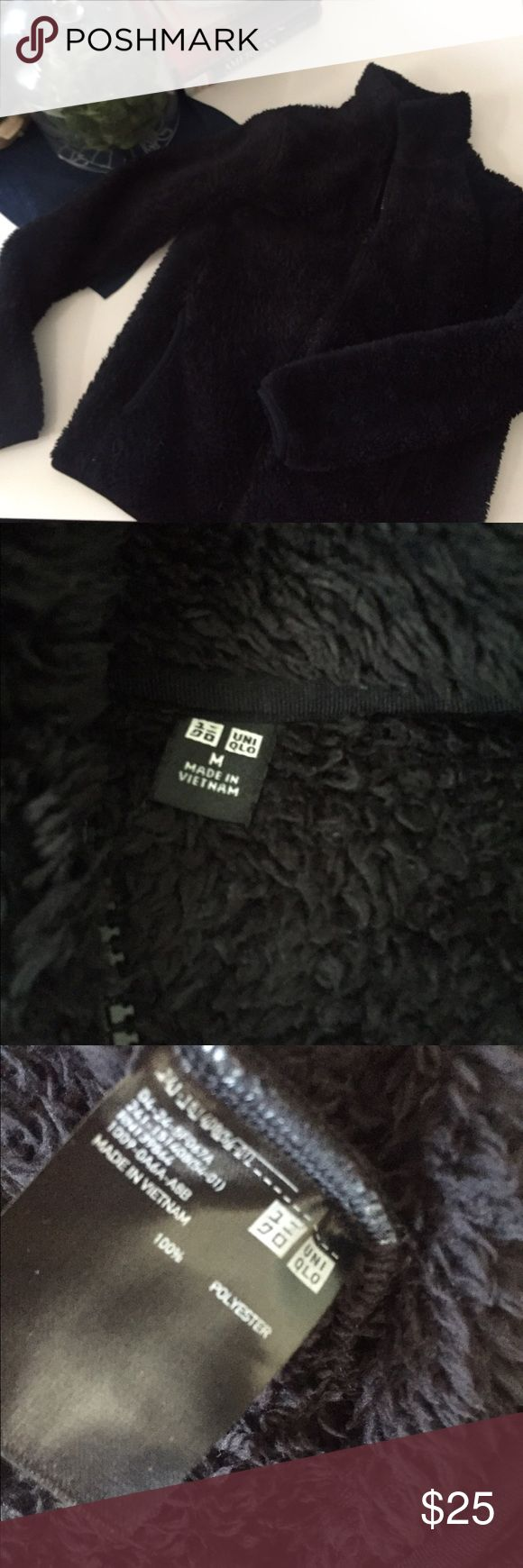 Uniqlo black furry zip up hoodie Worn literally once. Uniqlo furry black zip down hoodie. Size medium but it runs a snug medium or larger small:) Uniqlo Sweaters