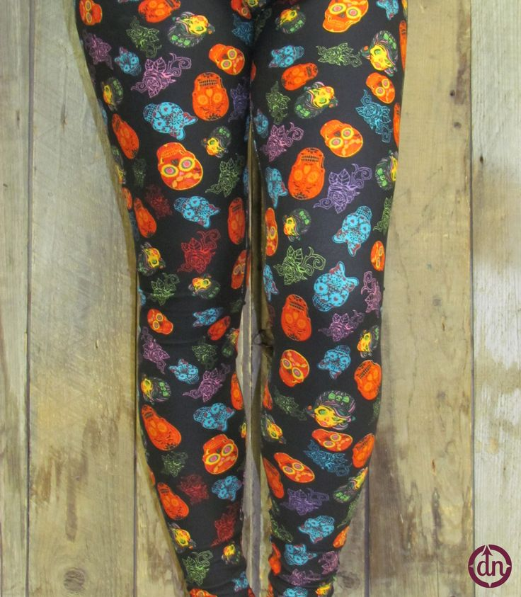 Delicious sugary sweet skulls cover these leggings from top to bottom in eye catching colors and one of a kind designs. Match these leggings with one of our black dolmans and boots for a nighttime look, or try on a burnt orange faith hope tank or a hello sunshine t-shirt for a new twist on a daytime look.