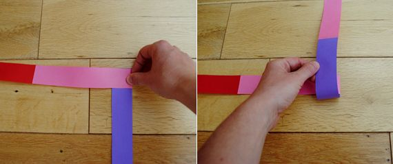 6. Fold the vertical strip up and crease.  7. Continue folding the horizontal and vertical strips in the same manner until you run out of paper (at which point you can glue the ends together or you can add more strips of paper to make the garland longer).