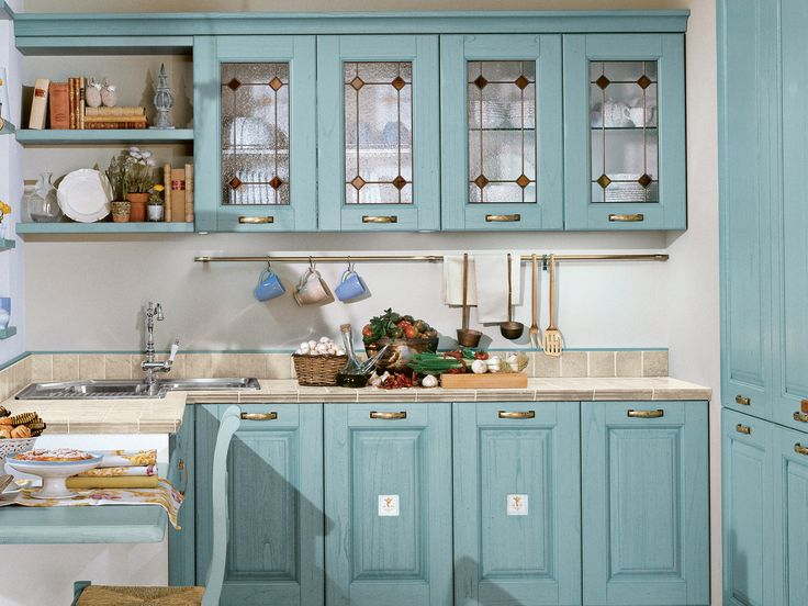 Laura is a #kitchen designed for people who cherish tradition, with its finely worked high-thickness solid #wood doors, display cabinet with glass-panelled or bound glass doors, and dedicated or simply antiqued handles.