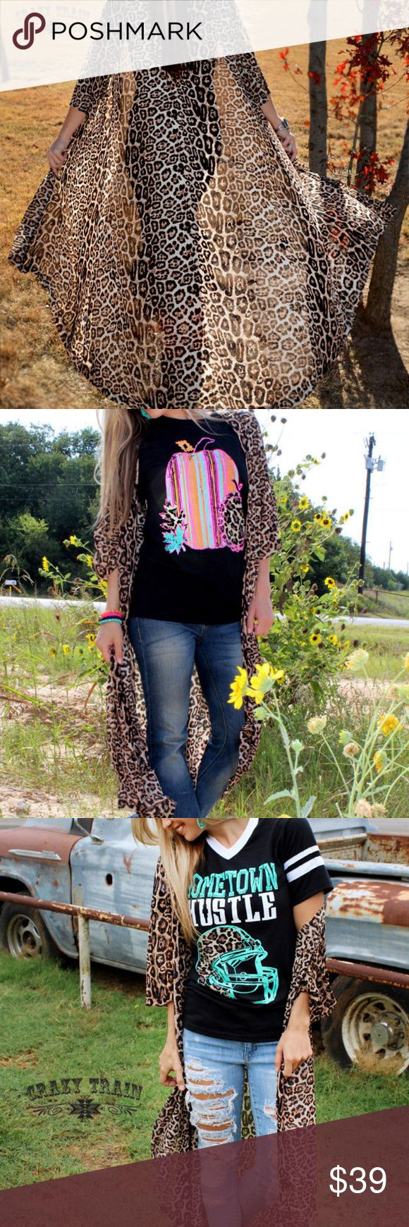 """Crazy Train Dixie Duster Cheetah Leopard Southwest Crazy Train Dixie Duster Cheetah Leopard Southwestern Boho Sizes Sm-Large  Boho, Southwestern style. Sheer, however heavier fabric. Long Southwestern boho style.  Please pay close attention to measurements rather than size. Sizing may not be """"typical"""" of standard sizing. Laid flat-Chest (armpit to armpit) Chest 17"""", Sleeves 18"""", Length 42"""" Crazy Train Tops"""