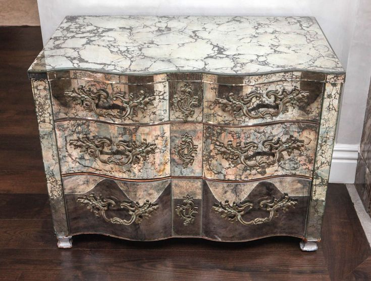 Pair of Midcentury Mirrored Serpentine Chests | From a unique collection of antique and modern commodes and chests of drawers at https://www.1stdibs.com/furniture/storage-case-pieces/commodes-chests-of-drawers/