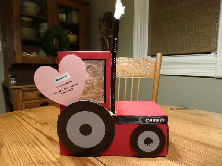 My boys were so excited to make valentine boxes for school but it was hard deciding which color tractor they wanted to make...My oldest son chose to make a Case IH!