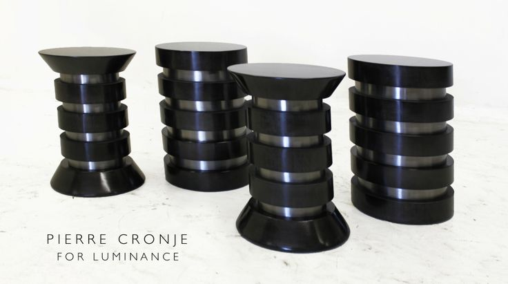 Pierre Cronje for Luminance Contemporary African stools.  High gloss rings around a pewtered iron column