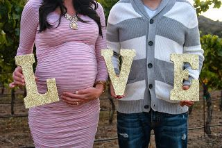 maternity photos savvychicmommy - this would be cute if each kid had a letter as well as Daddy