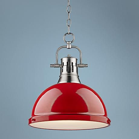 A frosted glass diffuser helps to eliminate glare from this contemporary red and pewter pendant light.