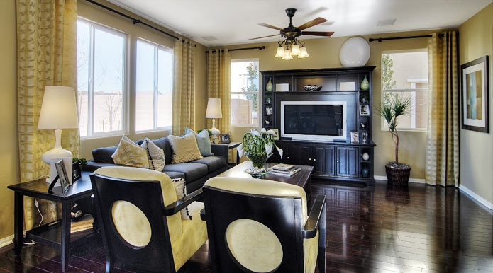 Soft Yellow Walls And Drapes With Glossy Dark Wood Floors