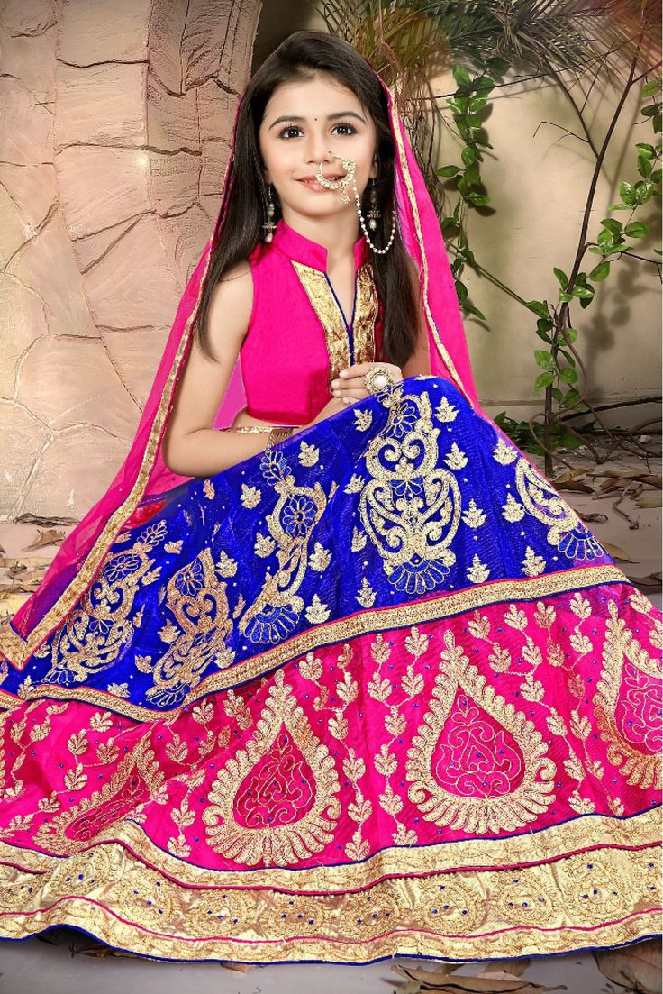 Dress up your little diva in a plush Net saree.The bright  Blue,Pink colour of the  Lehenga Choli looks charming and pretty. This Lehenga Choli will make your dear little angel look adorable for any s...