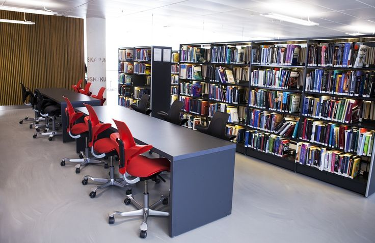 Black and Red HÅG Capisco Puls chairs in St. Olav's hospital library #education #InspireGreatWork # Scandinavian #design
