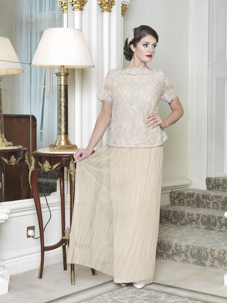 1960s inspired styling. Embellished top, boat neckline with short sleeve and french pleated tulle skirt. Taken from 2015 wedding collection by Ginan Abbas. www.goldenstitch.ie
