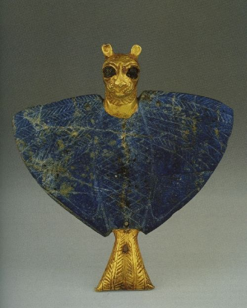 """The lion-headed eagle or imdugad, a lesser divinity in Sumeria; the gold head attaches to the lapis lazuli body with tiny copper nails and bitumen (a petroleum product with the consistency of tar). Feathers are finely etched on the wings. The pendant is inscribed """"Messanapada of Ur,"""" 2500 BCE - Treasure of Ur Palace of Mari. Nat'l Museum of Syria."""