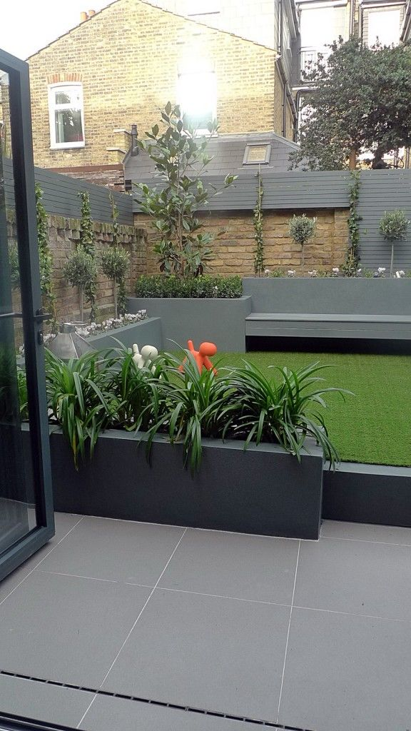 modern small low maintenance garden fake grass grey raised beds contemporary planting chelsea london