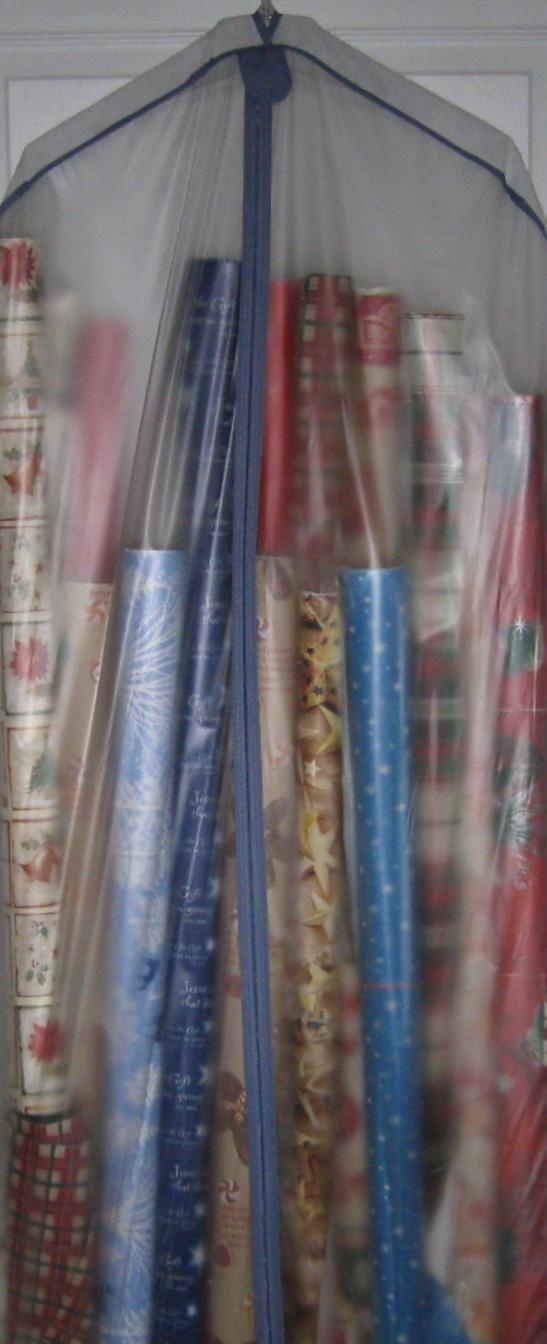 DIY Gift Wrap Organizer : use a clear garment bag for storing gift wrap supplies. Good for the storage closet