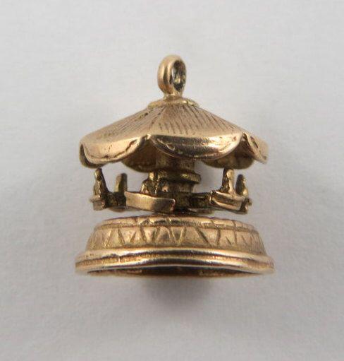 Carousel Mechanical 9K Gold Vintage Charm For Bracelet by SilverHillz on Etsy https://www.etsy.com/listing/235156305/carousel-mechanical-9k-gold-vintage