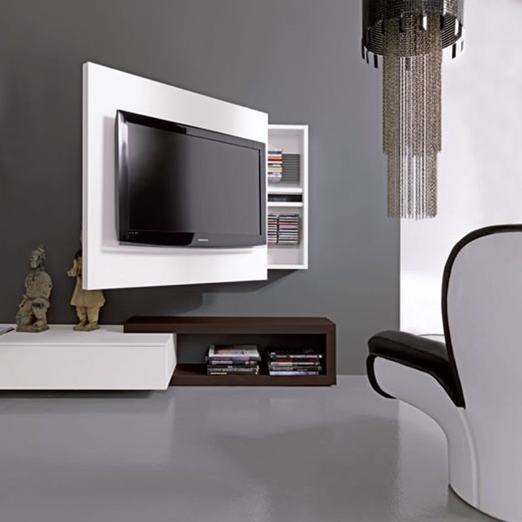 TV Rack Cleverly Combines Media Storage And A Rotating Stand Into One Sleek Unit