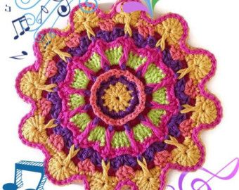 Crocheted Flower Potholder/Trivet/Hot Pad This potholder/trivet is made from an All Sylvias Creations original pattern.  For this listing, I have hand-crocheted this lovely mediterranean pot holder/trivet from my own original pattern. You will not find this potholder pattern anywhere else.  I used 100% cotton thread which will take the heat without melting, unlike acrylic yarn. I used a variety of colors that contrast well from each other. The colors remind me of a . I cro...