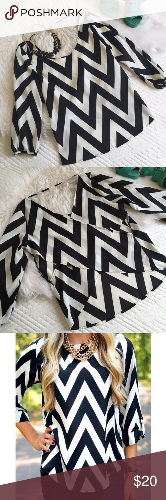 🆕 CHEVRON TOP Trendy black and white chevron top. EUC. Perfect for work or lunch with friends!  Has thin neck strap and unique cross-back design with peek-a-boo sides and lower back (shown in photo 2 above).   100% polyester. Dry clean only. Foreign Exchange Tops Blouses