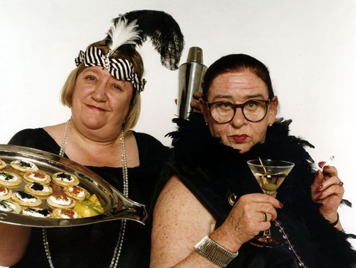 """2014 in film and TV : Clarissa Dickson-Wright, English television presenter, died March 15, at the age of 66.  She was one half of the immensely popular cooking duo, """"Two Fat Ladies"""" (pictured).  Dickson-Wright is at the left,  with Jennifer Paterson (1928-1999)"""