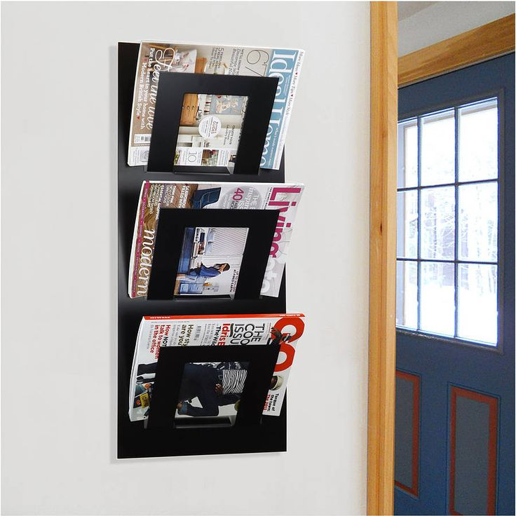 wall mounted three tier magazine rack by the metal house | notonthehighstreet.com