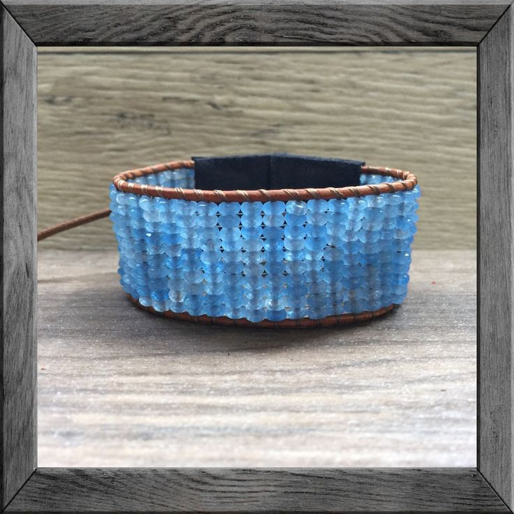 This single wrap bracelet features genuine blue jade faceted rondelles with distressed navy blue suede ends.  Beautifully handcrafted, this wide cuff looks great layered with a mala bracelet.