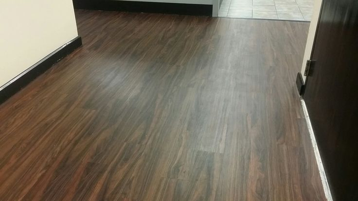 "2mm Luxury Vinyl Planks in ""Natural Walnut"". Installed in a University Admissions office in South Florida. Patriot's Provincial Series is available in a larger 6"" x 48"" plank and makes a bold statement in design, color, and character."