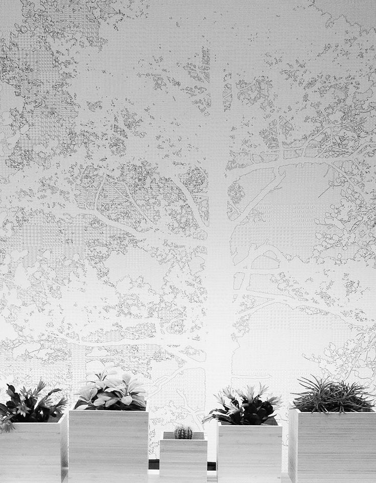 love this white on white forest mural by talented Scandinavian Surface ... this design is cleverly made up of miniature animals... Currently on display in our studio...