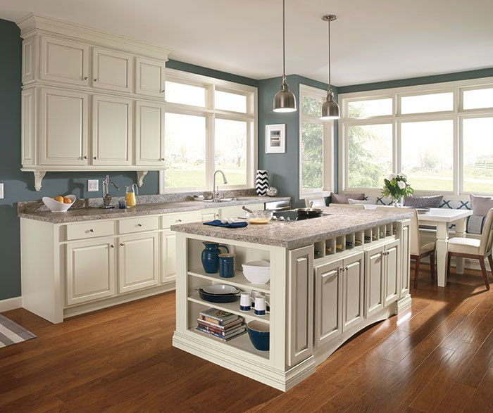 White Granite Avalanche With Dark Kitchen Cabinets