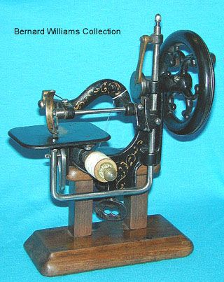 """This unusual 1860's miniature was aptly known by the name """"Novelty"""". It features a built in table clamp. The needle penetrates the stitch plate from below to perform a chain stitch"""