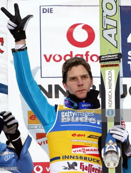 Janne Ahonnen of Finland flashes a three sign as he celebrates his third victory of the Four hills competition part of the FIS World Cup in...